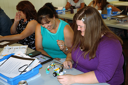 Two teachers working on a project during a workshop